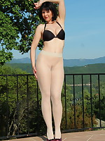 Transparent pantyhose and a black bra