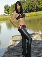 Desyra Noir posing in nature dressed in black