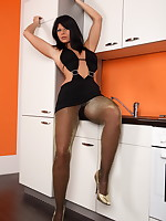 Things got hot in the kitchen as I turn up the heat in my tight skirt and pantyhose