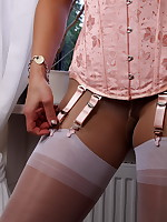 White nylons and some pantyhose is something you can find in these sexy scene with a hot babe. She is also wearing a pink corset that makes her especially sexy