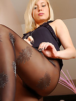 Freshly showed blonde puts on her festive black glittery pattern pantyhose