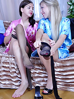 Pretty lez girlfriends don their new shiny tights for a wet nylon quickie